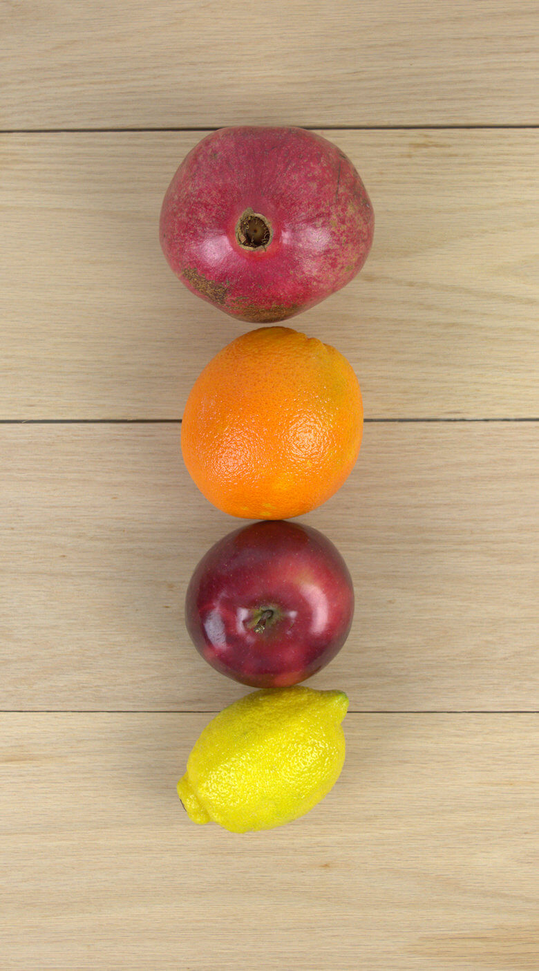 Picture of apple, lemon, orange and pomegranate