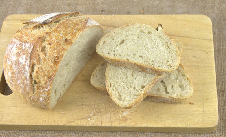 Picture of cut Artisan No-Knead Country Bread on wooden board