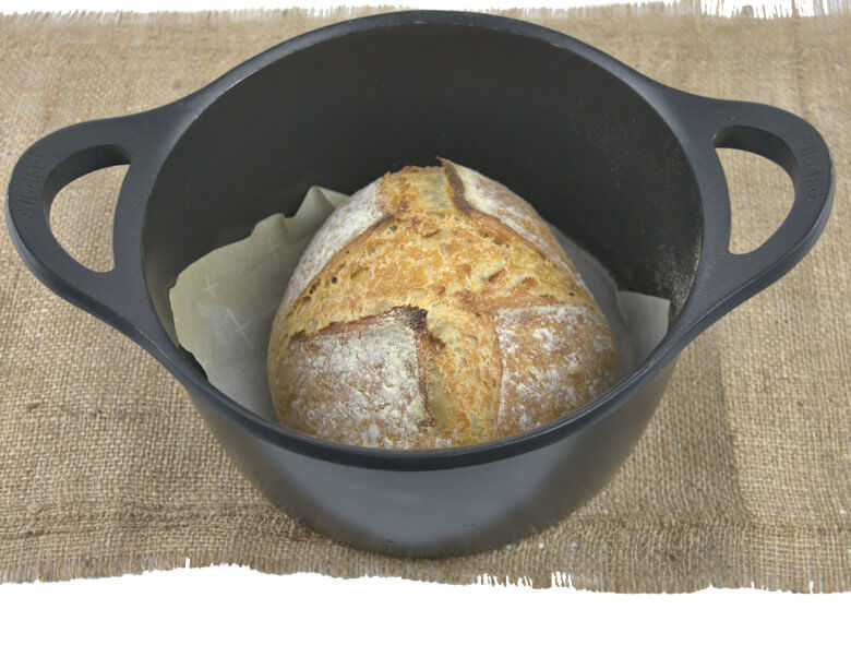Picture of whole loaf of artisan no-knead country bread in Dutch oven
