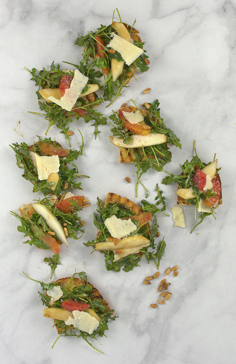 Picture of Arugula Pear Orange and Pecorino Salad on toast