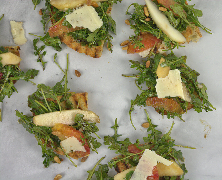 Picture of salad served on toast.
