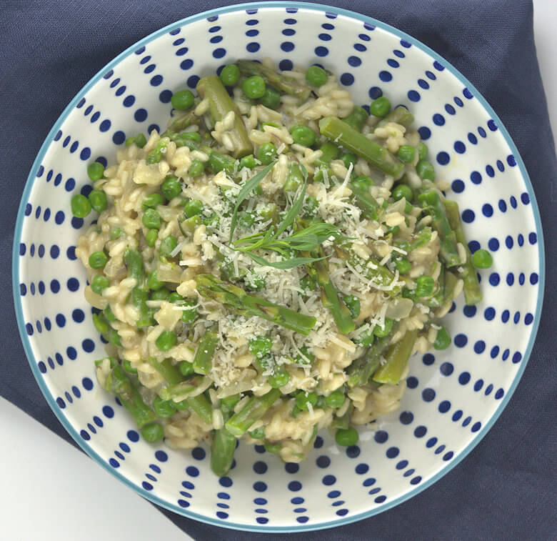 Picture of bowl with Asparagus and Peas Risotto in foucs