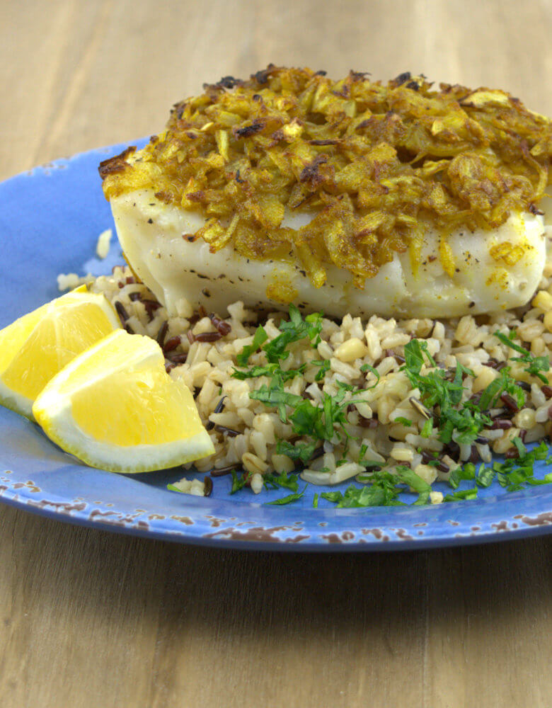 Picture of Baked Cod with Onion Curry and Ginger on rice with lemon
