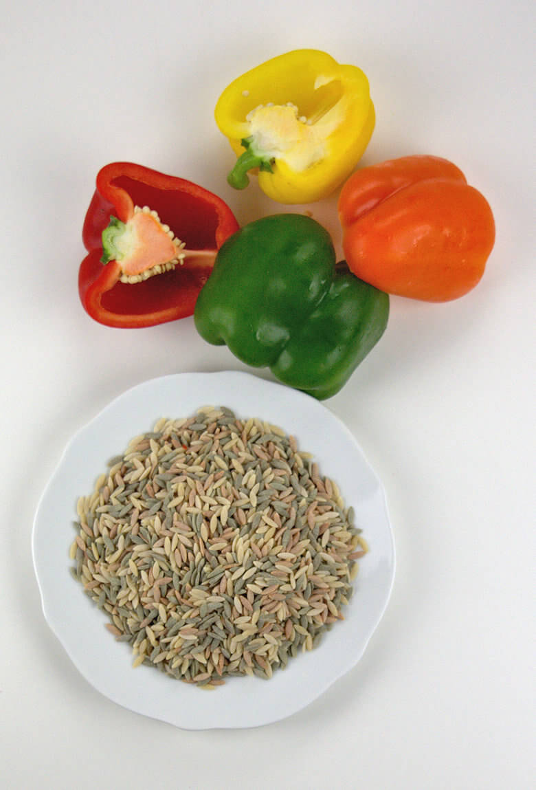Picture of uncooked orzo and 4 different colored bell peppers