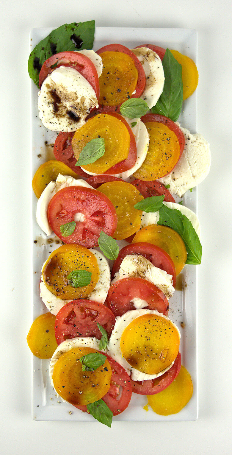 Picture of a white plate with Caprese Salad with Yellow Beets