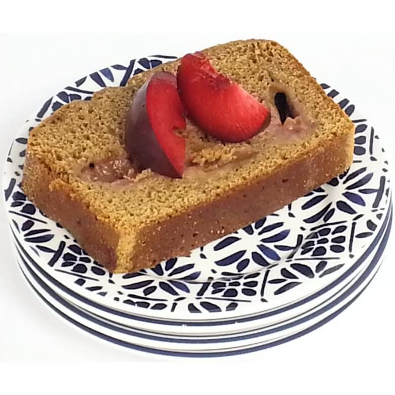 Picture of slice of Cardamom Cake with Red Plums on stag of plates