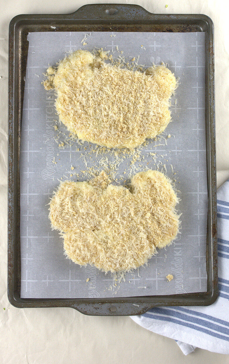 Picture of coated Cauliflower Steaks on baking sheet