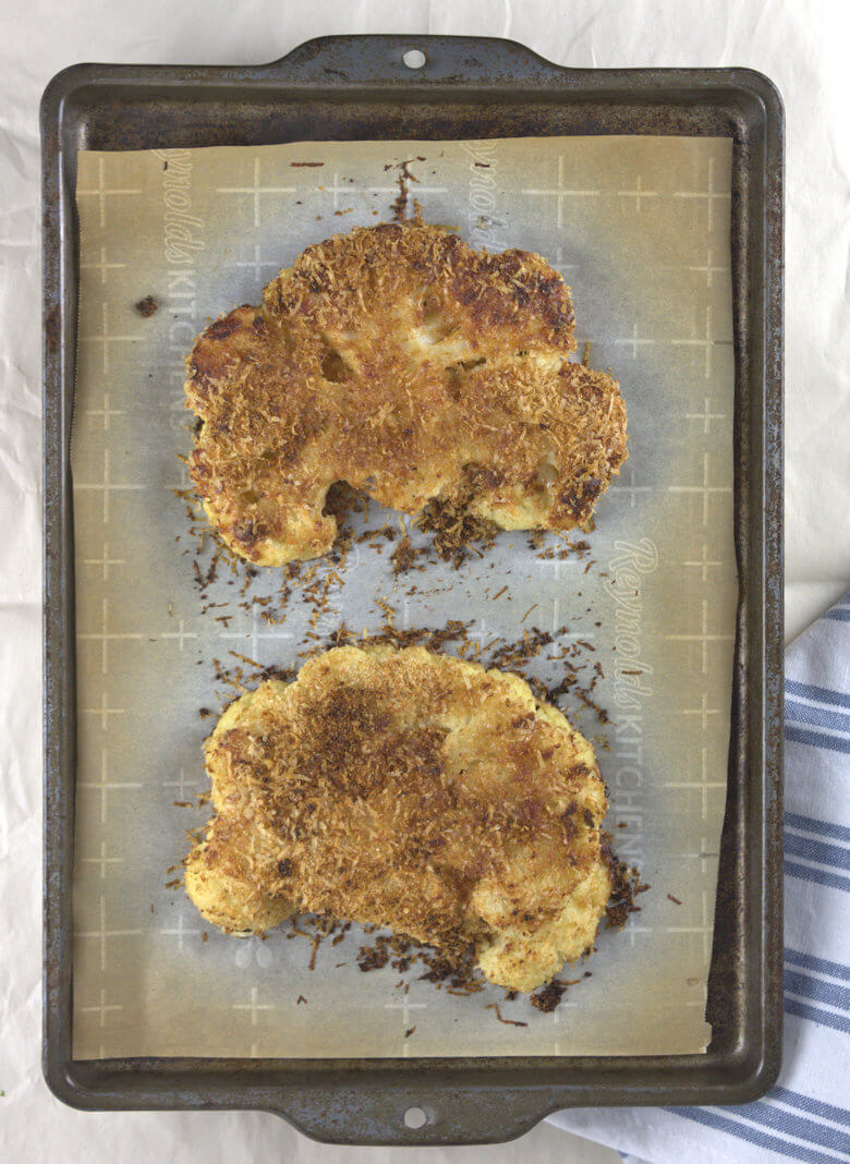 Picture of cooked cauliflower Steaks on baking sheet