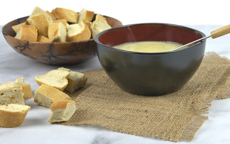 Cheese fondue pot with bread