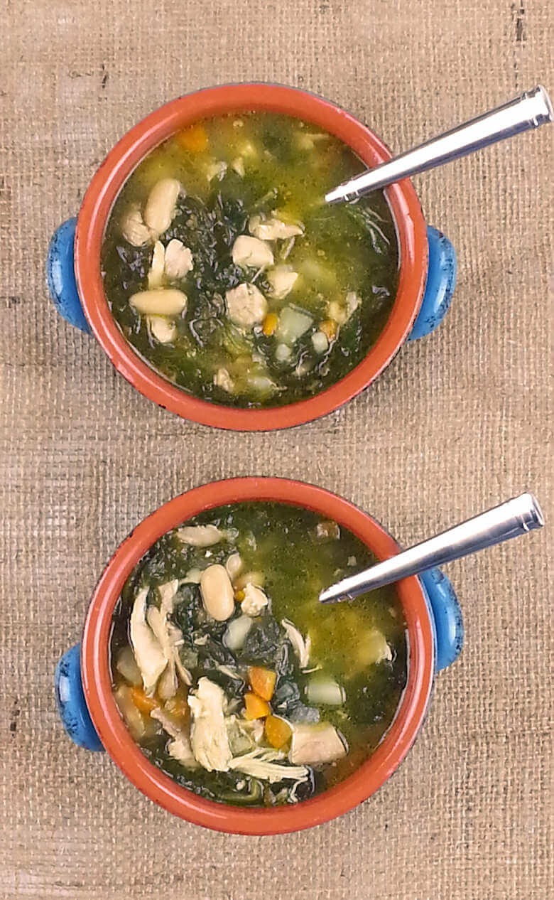 Picture of 2 bowls of Chicken Soup with Potato and White Beans