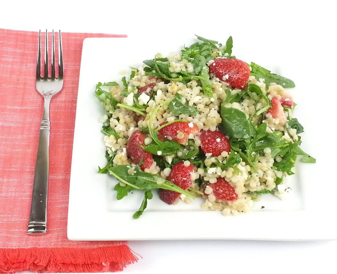 Picture of Couscous Arugula Strawberry Salad on plate with fork.