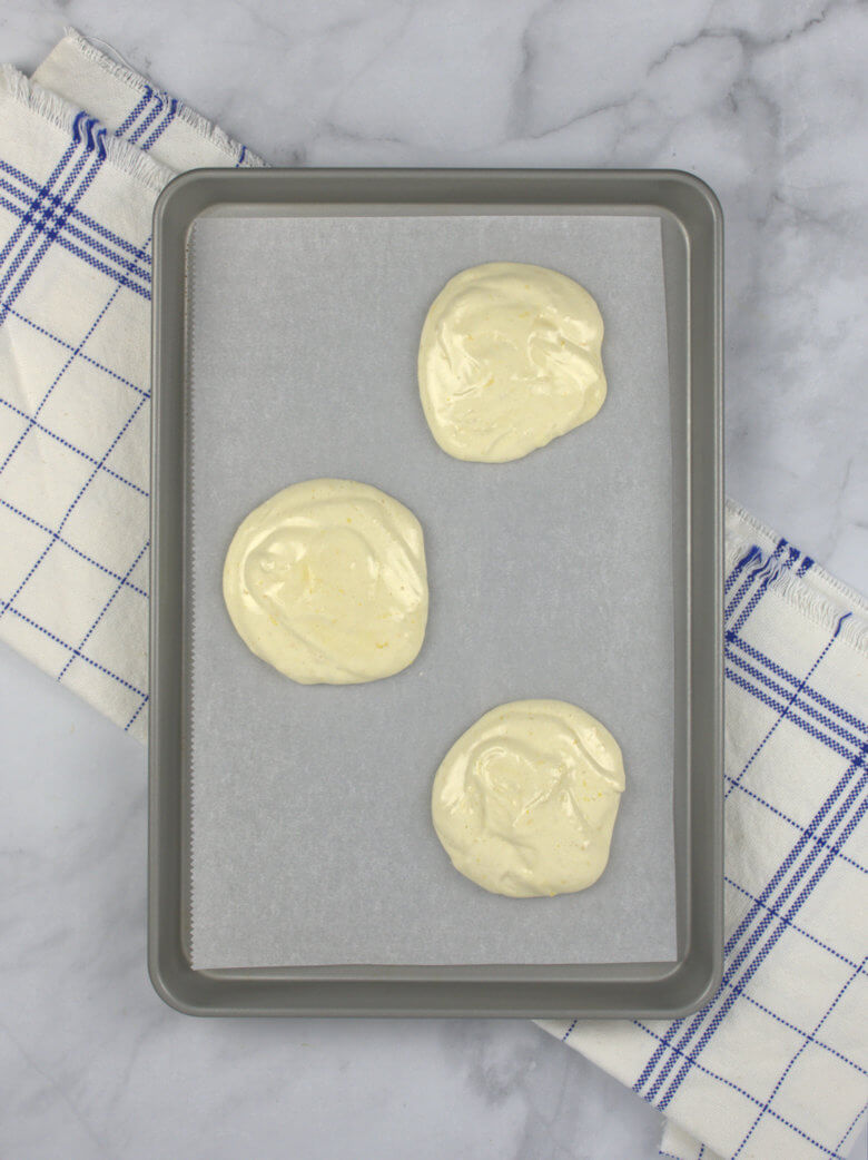 3 scoops of Egg cakes on baking sheet