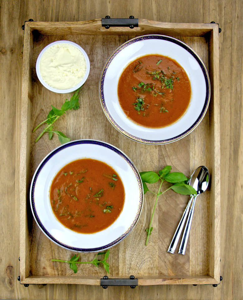 Picture of fresh tomato soup with creme fraiche separately