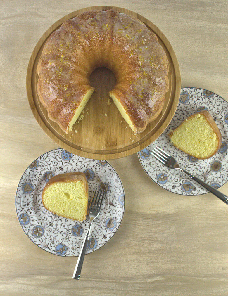 Top down picture of Light Orange Buttermilk Bundt Cake and 2 slices