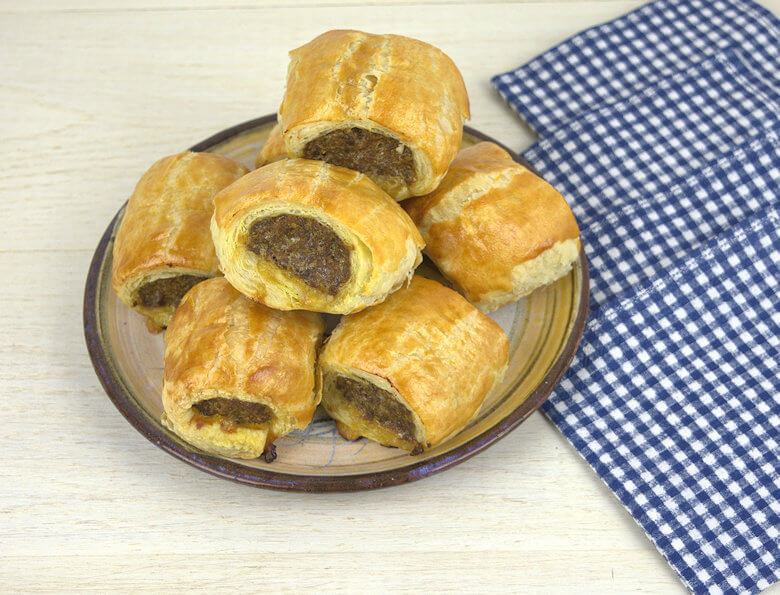 Picture of plate with mini sausage rolls.