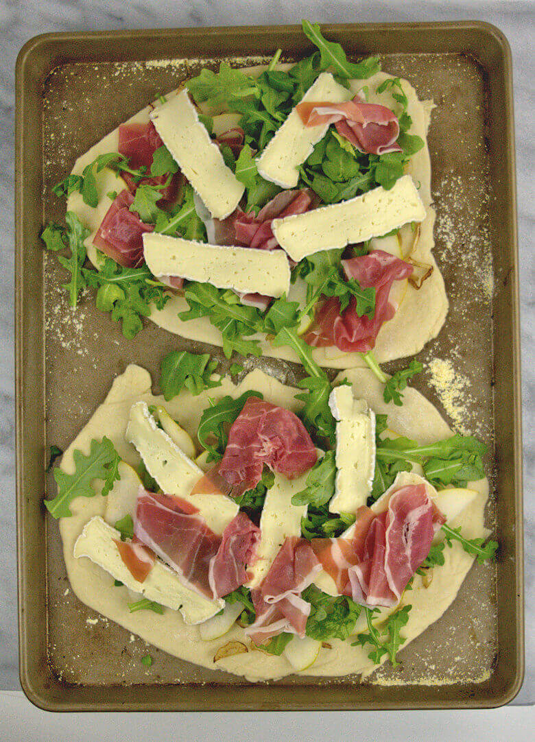 Picture of 2 Pear Brie and Prosciutto Pizzas before they go into the oven