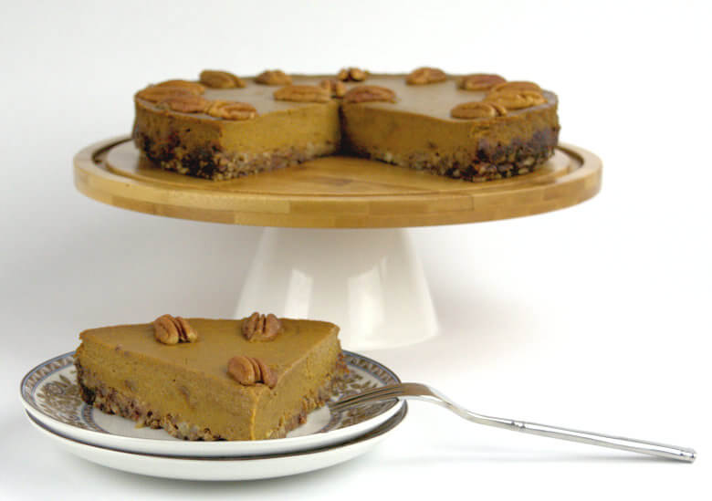 Picture of Pumpkin Pie on Date-Pecan Crust on pedestal and wedge on plate