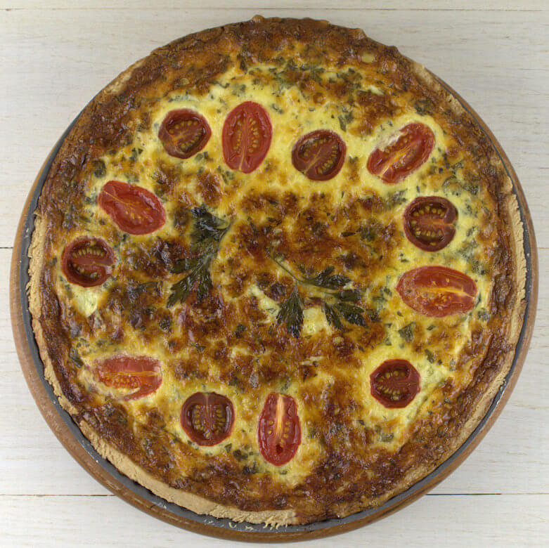Top down picture of Quiche Lorraine with Tomatoes