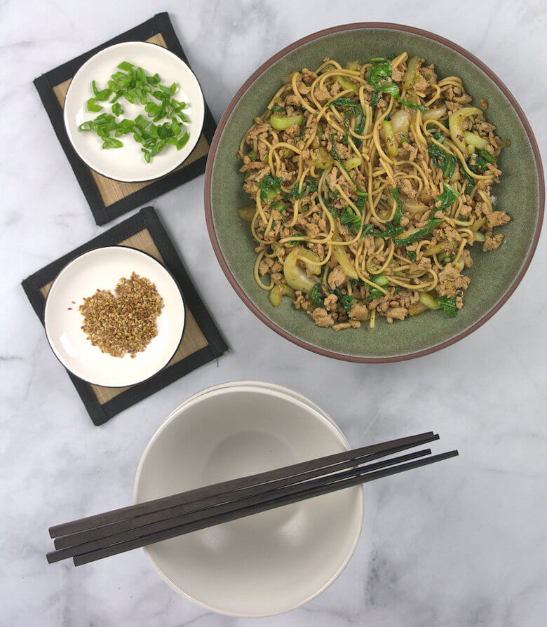 Picture of a large bowl with noodles and scallion and toasted sesame seeds  separately.
