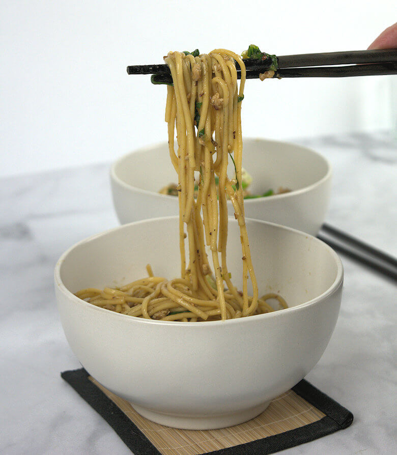 Picture of Eating Stir Fried Udon Noodles with Bok Choy