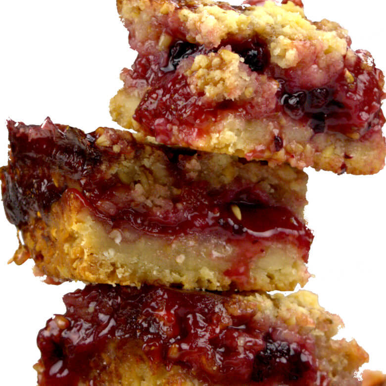 Close up picture from the side of Strawberry Oat Macadamia Bars