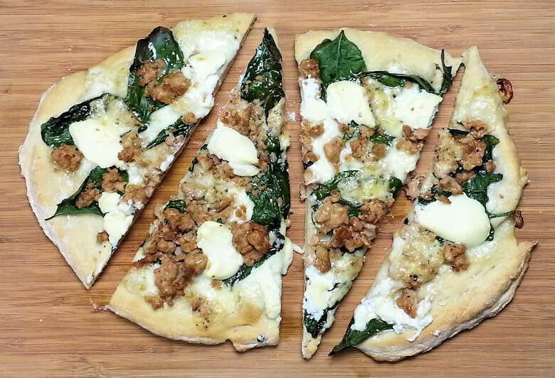 Picture of cut White Spinach and Three Cheese Pizza